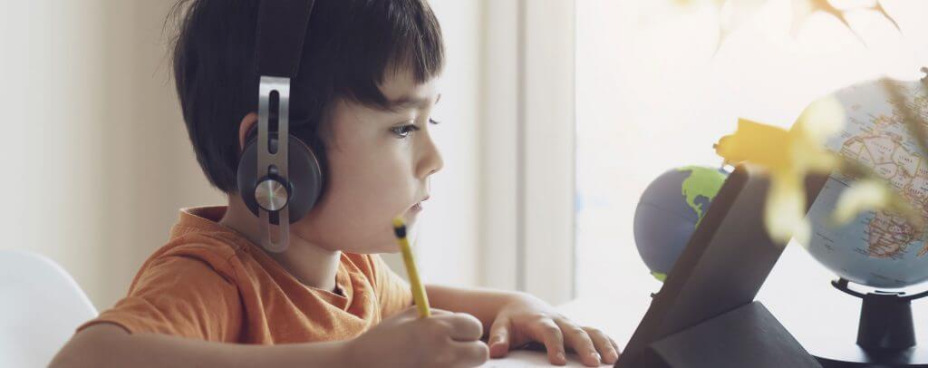 a kid enrolled in online school doing homework