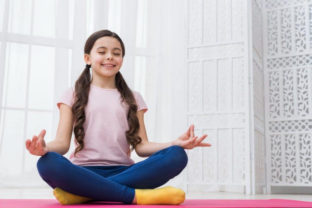 To overcome the stress caused by the hectic learning schedule of children, yoga is proven very beneficial for the kids.